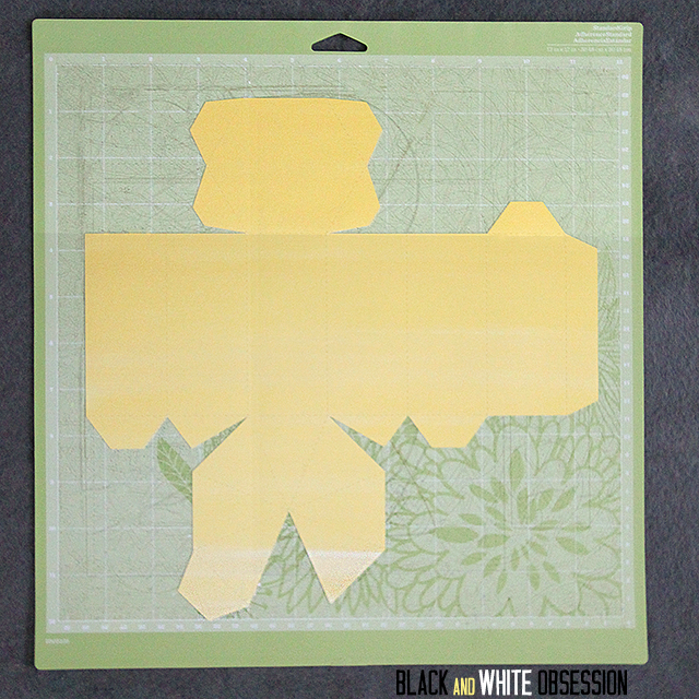 Cut out the hexagonal cone prism template from scrapbook paper | Geometric Favor Box | www.blackandwhiteobsession.com