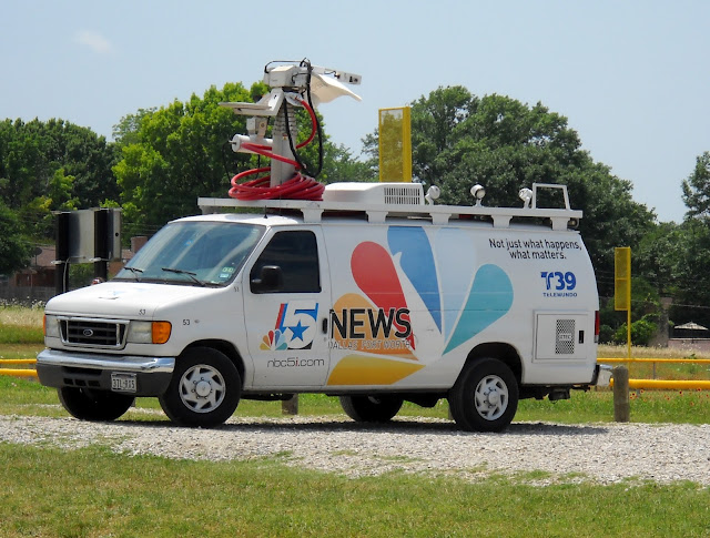 TV crews covered the protest at Winfrey Point, White Rock Lake, Dallas, TX
