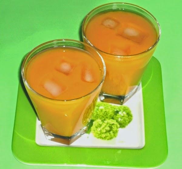 mango lemon ginger juice in serving glasses