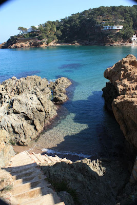 Clear water of Sa Riera beach in La Costa Brava
