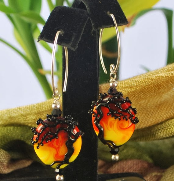 https://www.etsy.com/listing/175691209/black-tree-earrings-red-orange-and?ref=shop_home_active_1