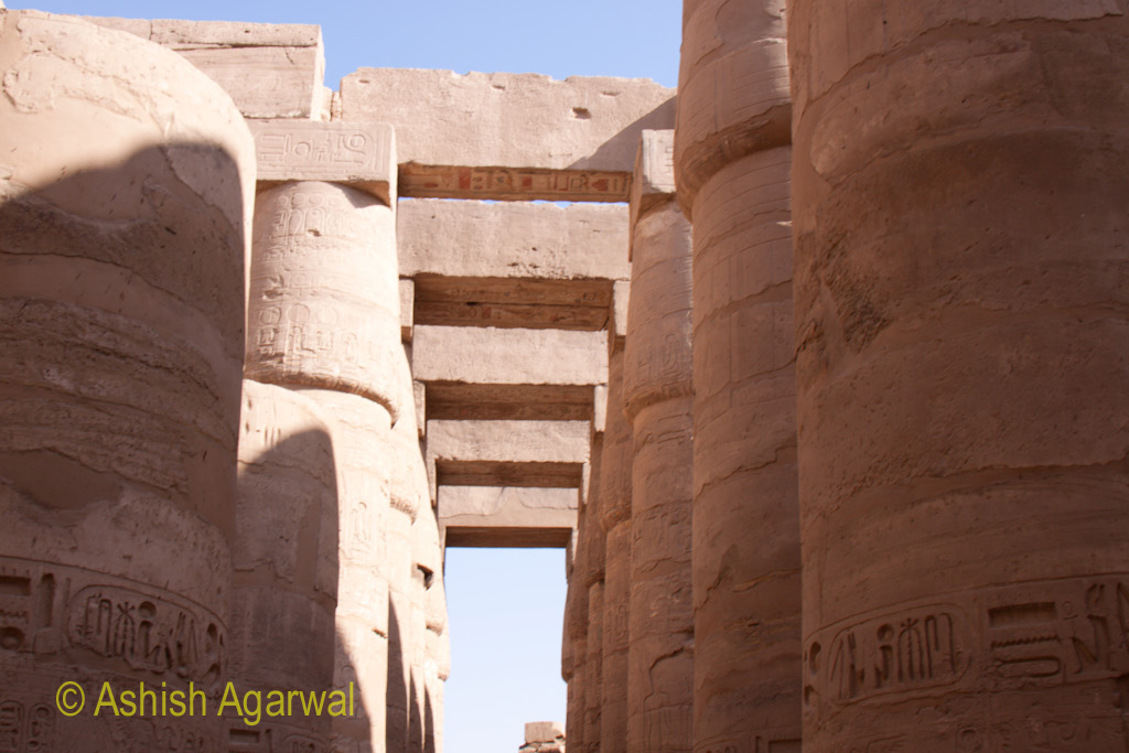 Many pillars of the Hypostyle Hall in the Karnak temple covered by architrave at the top
