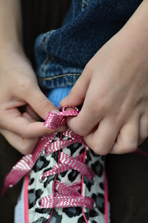learning to tie your shoe, push the second lace through and grab the second loop