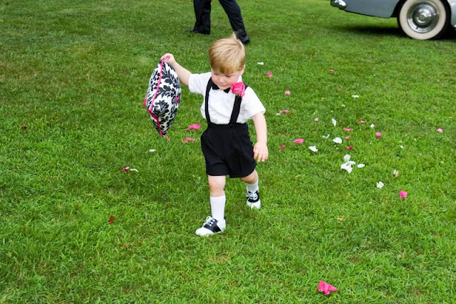 Ring bearer with damask ring pillow at black, white, and pink wedding