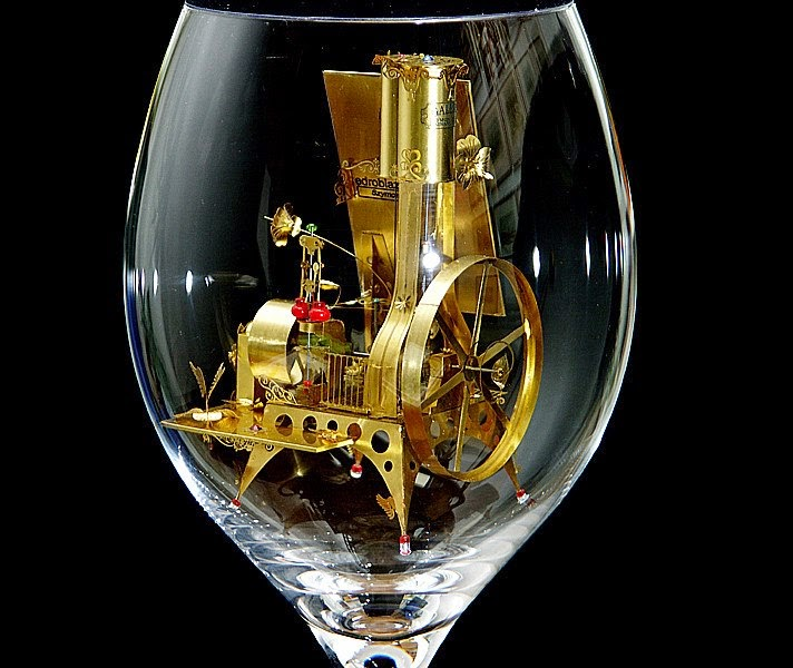 07-Solar-Kinetic-Miniature-Sculptures-in-a-Glass-Goblet-www-designstack-co