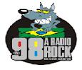 (A Radio Rock 98 FM)