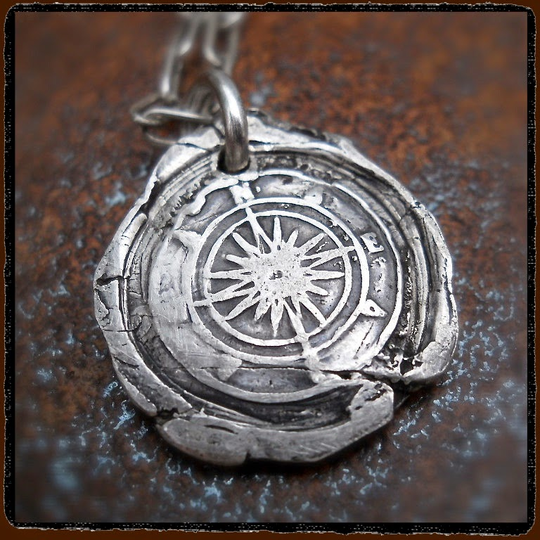 "<img src=""wax seal Compass Pendant  from Your Daily Jewels.jpeg"" alt= ""wax seal Compass Pendant"">"