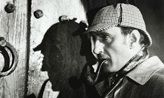 Bolac and white photo of Sherlock Holmes