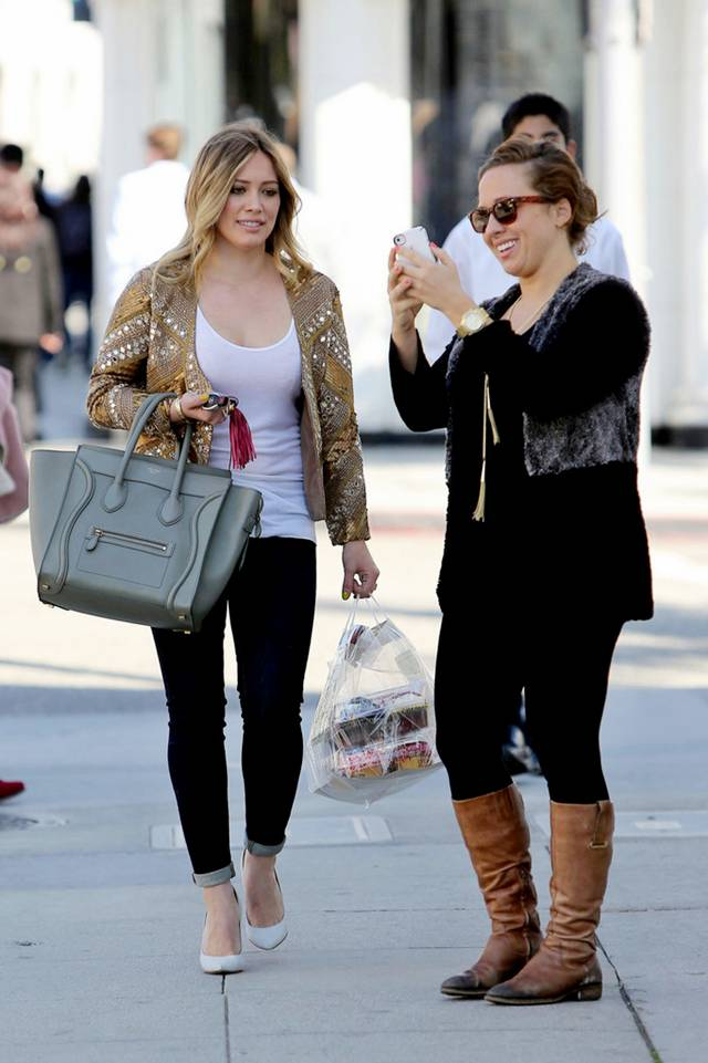 "Hilary Duff shopped in Beverly Hills on Tuesday (February 12). The ""Lizzie McGuire"" star looked cute in a sparkling gold jacket, white top, and dark skinnies as she smiled at awaiting shutterbugs."