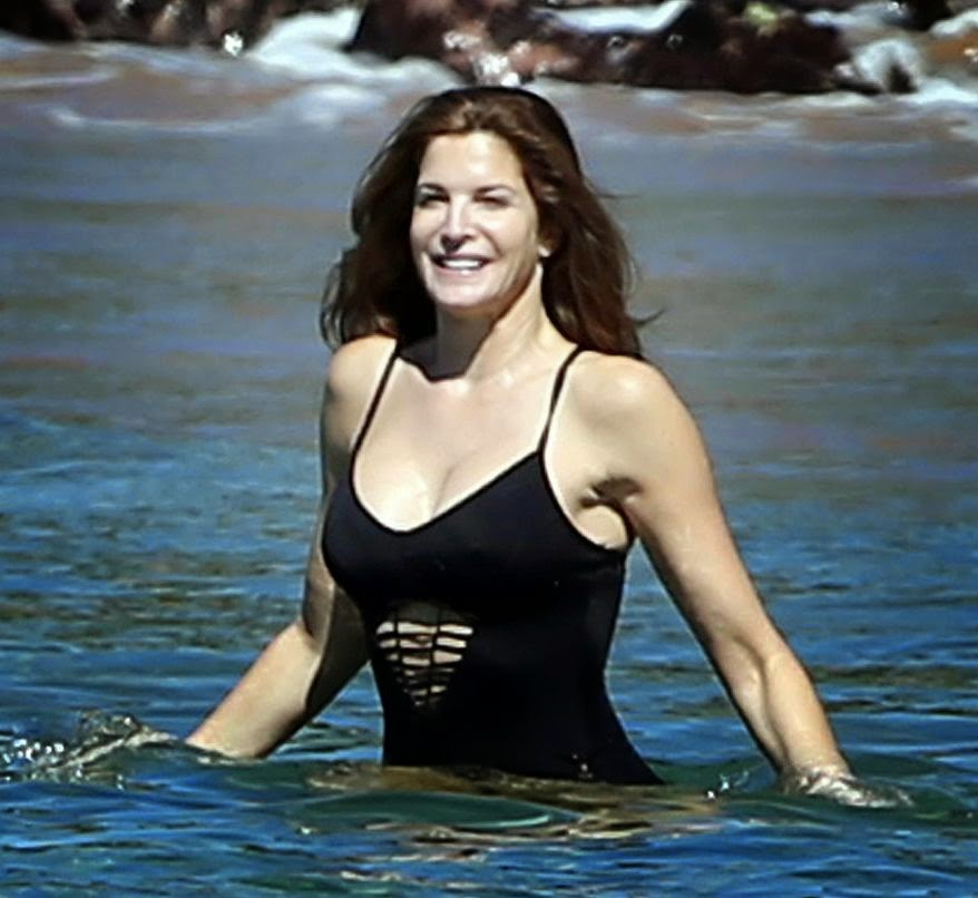 What a great attitude? Stephanie Seymour was recently asked if she had found the holy grail secret on how to be the perfect mother. . . . . . . . .And the world got an answer!!!  This whole situation continued to makes us really glad as the 50-year-old makes a splash with this swimsuit for the Christmas day and New Year's Eve 2015 on family holiday at Hawaii, USA on Thursday, December 25, 2014.
