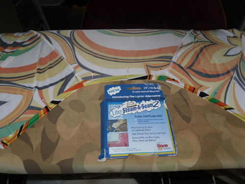 After pressing the neckline edge under, topstitch it in place. I used ...