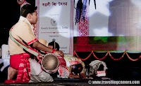 Semi Classical Performance on Pulok banerjee's song 'Phulore Melate' : Posted by VJ SHARMA : This year during April, Assam Association Delhi organized Rongali Bihu Festival 2011 by @ Indira Gandhi National Center of Arts, New Delhi, INDIA and here are some of the photographs from Semi-Classical performance by Bidisha during the evening...Bidisha is the performer here and she is performing a semi classical dance on Pulok banerjee's song 'Phulore Melate'This song was beautiful as the performer is !!! I have added song in the bottom of this post, so just play it and enjoy with dance steps of Bidisha ...Expressions of this dance form were awesome and not sure if credit should go to Dancer Performer of Dance form itself :) .. But in my opinion mix of both did a great job during Bihu Festival !!!Various types of Expressions made this dance more interesting...Bidisha is weraing Mekhela Sadar here !!! Mekhela Sadar was again a beautiful attire with awesome expressions of the dancers on Fantastic Music in the backgrond !!!Traditionally muga(special silk of assam) is used to make mekhela - sadar (equivalent of Saree in Assam) for girls and kurtas for boys. Till date it is considered to be the most sophisticated attire in Assam.Loved this expression ...Muga silk is one of the many natural gift to Assam. The specialty of this silk is that it has golden bright color.