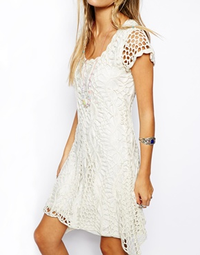 http://www.asos.com/ASOS/ASOS-Crochet-Dress-with-Flared-Hem/Prod/pgeproduct.aspx?iid=3606012&SearchQuery=crochet%20dress&Rf-200=20,5&sh=0&pge=1&pgesize=36&sort=-1&clr=Cream