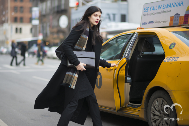 Model Larissa Hofmann trying to take a yellow cab during New York Fashion Week NYFW
