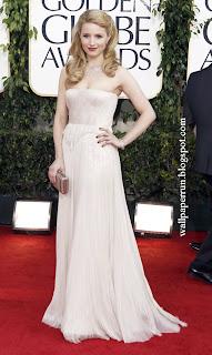 Dianna Agron arrives at the Golden Globe Awards Sunday, Jan. 16, 2011