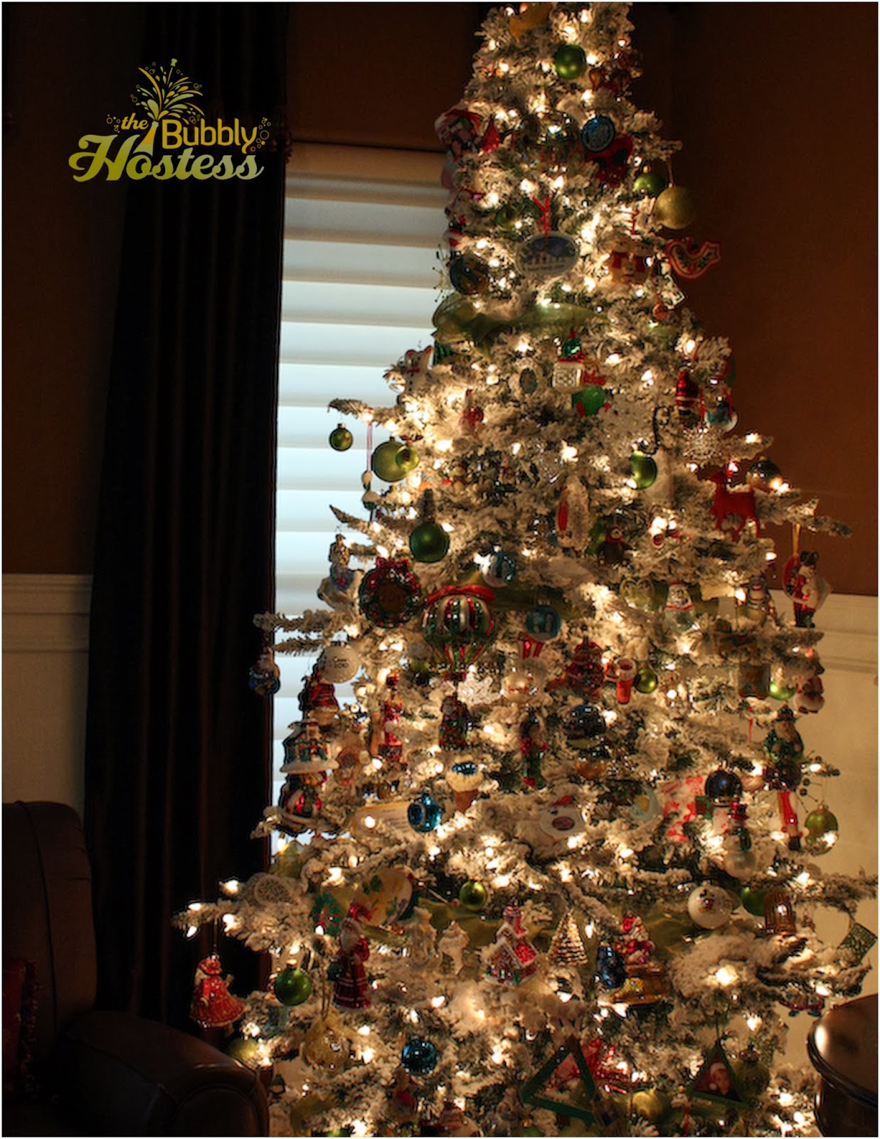 Flocked christmas tree decorated with old new and