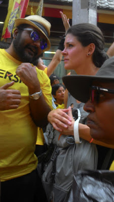 "alt=""Bersih 4: protestor explain Bersih 4 to tourist"