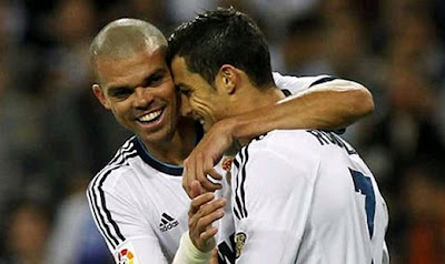 Cristiano Ronaldo celebrates a goal with Pepe on Real Madrid jersey