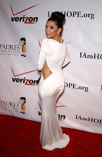 Eva Longoria looks sexy in a floor length white dress
