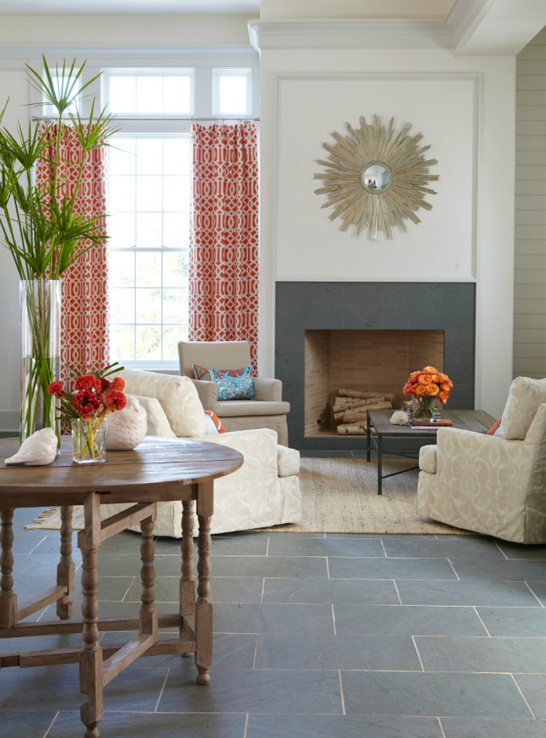 Coral and aqua prints in coastal living room