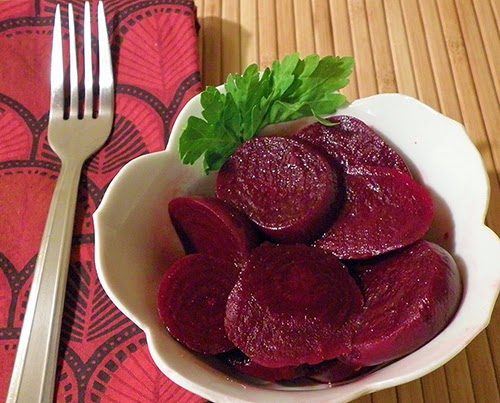 Bowl of Marinated Beets Garnished with Parsley
