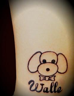 Cute puppy tattoo on the leg
