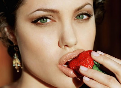 angelina jolie enjoying a strawberry -- really cute