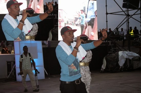 Reminisce performing on stage picture