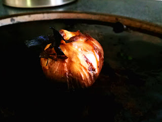 garlic on cooking sheet after roasting by artist Rickbischoff