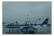 . traveling through gray, rainy and rather shabby LaGuardia Airport. (usairdeice)