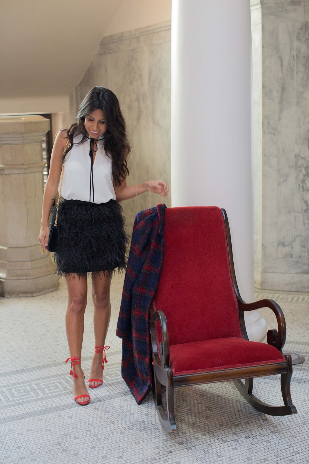 how to style feather skirt, holiday outfit ideas, raye red heels