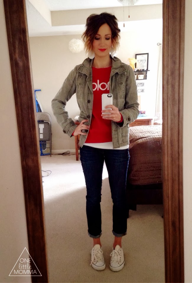 red lip, military jacket and graphic sweatshirt