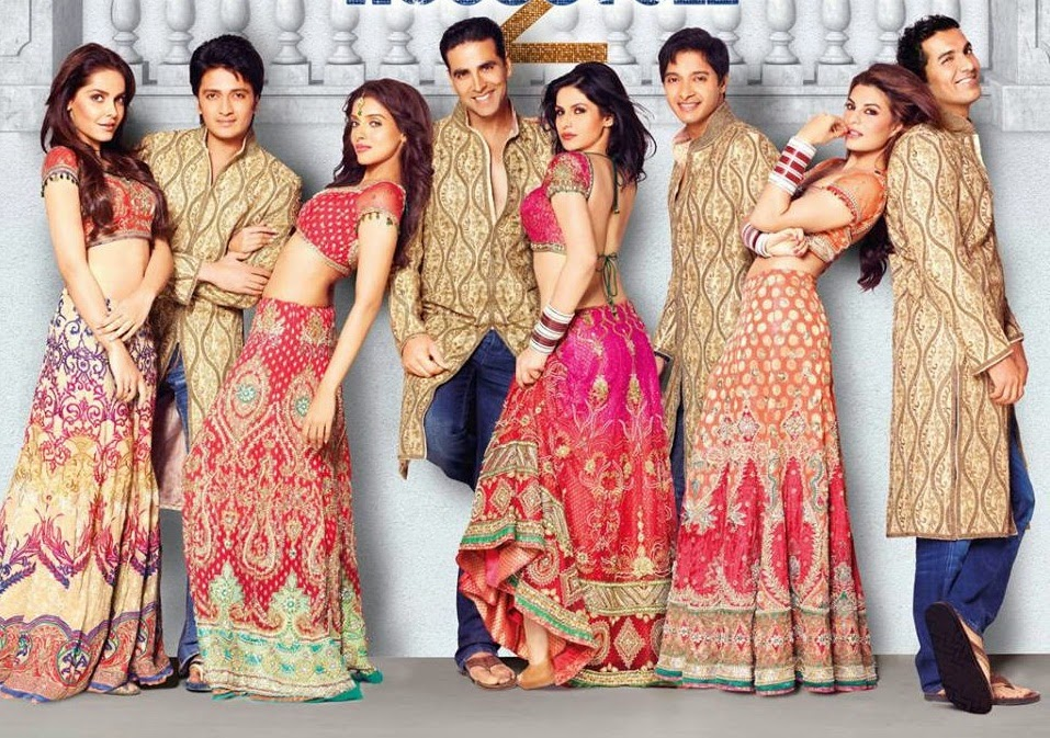 Zareen Khan And Other Bollywood Superstar Heroines Are Dressed Up In Bridal Dresses Of Various Color There Is Pink Dress Maroon