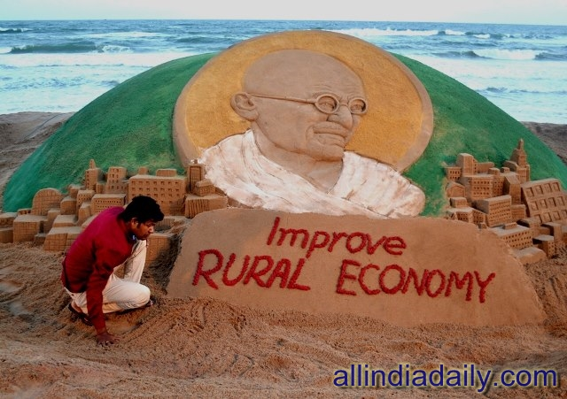 On the eve of Gandhi Jayanti Sand sculpture of Mahatma Gandhi with message' Improve Rural Economy' which is created on the occasion of Gandhi jayanti at puri beach of odisha by Sudarsan Pattnaik