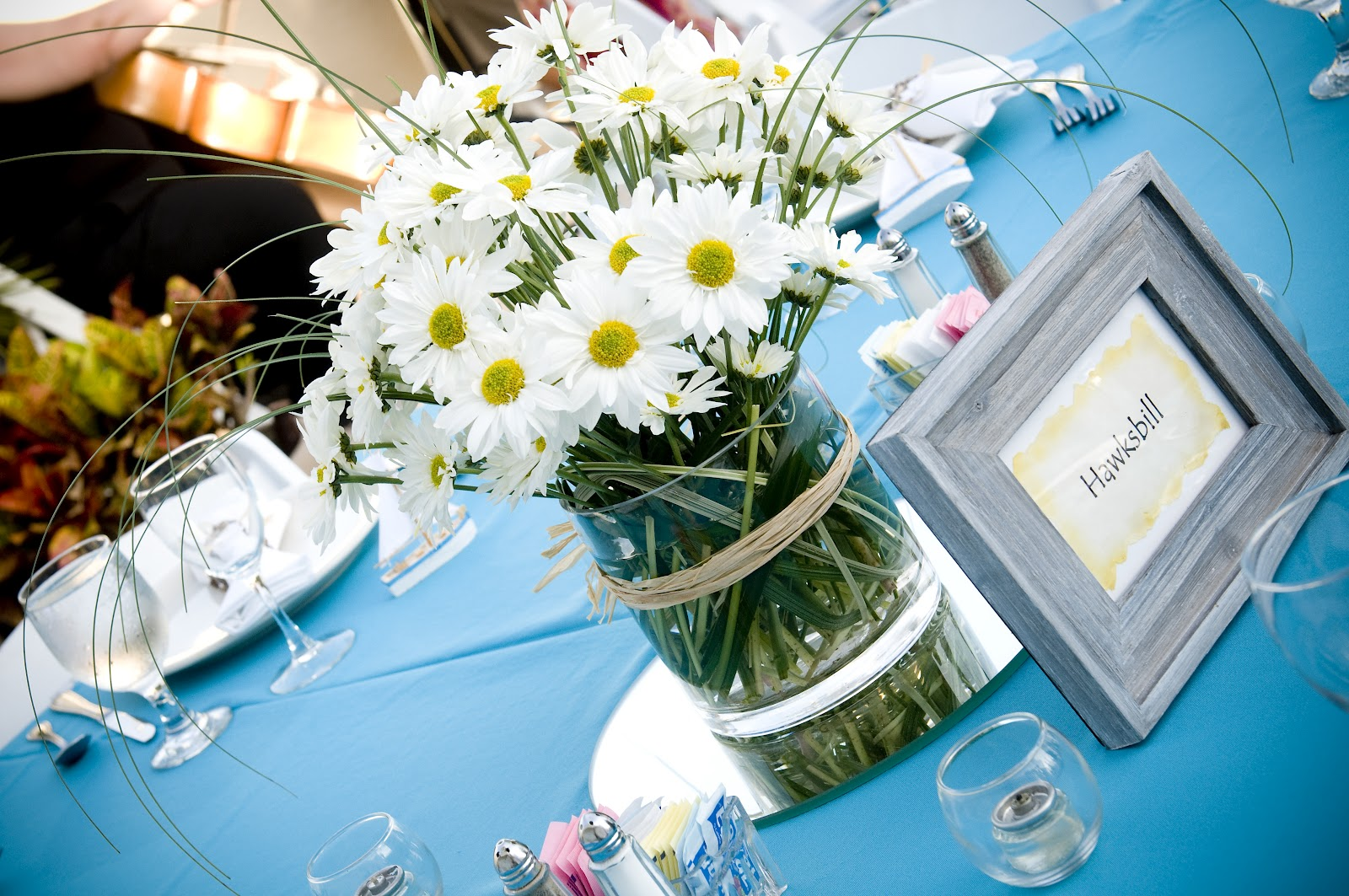 Susan snyder beach wedding flowers beach wedding daisy centerpiece in glass vase with rafia reception centerpieces izmirmasajfo