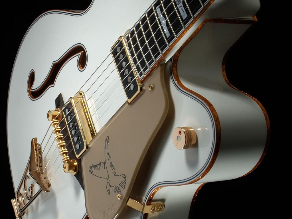 http://1.bp.blogspot.com/-QZ7i_TjPpG0/TmYX6LbchmI/AAAAAAAAC9g/s5omlYbUKIU/s1600/Guitar+wall+papers+15.jpg