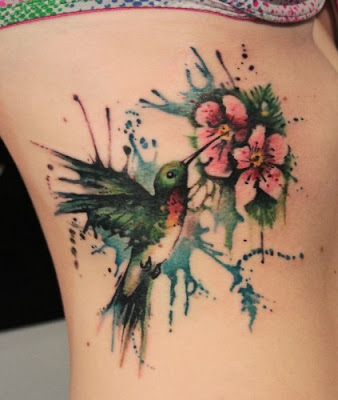 Ink Splash Humming Bird Tattoo