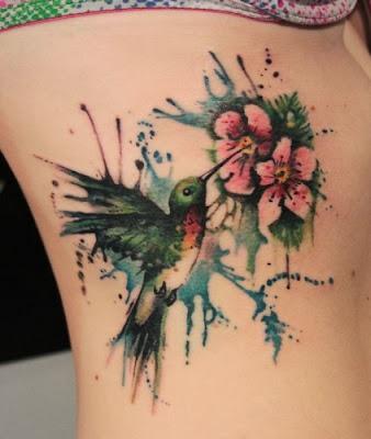 Ink Splash Humming Bird Tattoo