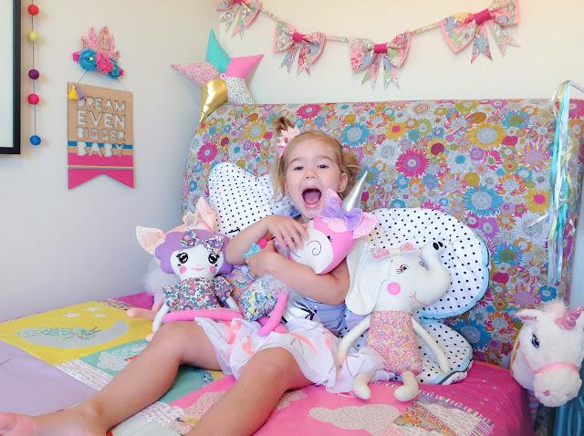 Isla cuddling her dolls