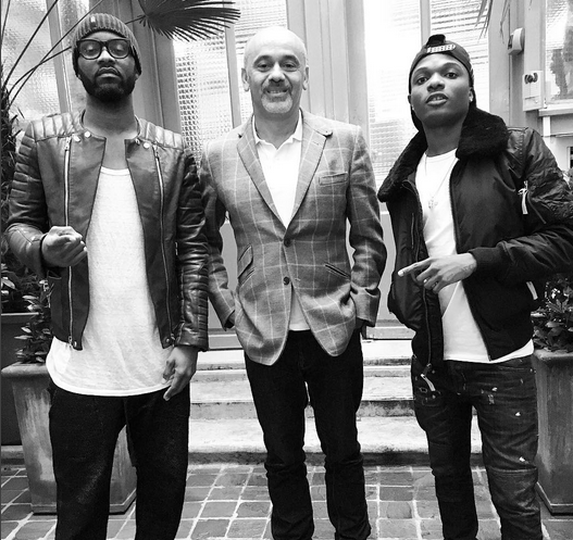 Wizkid and Fally Pupa hang out with shoe designer Christian Louboutin.