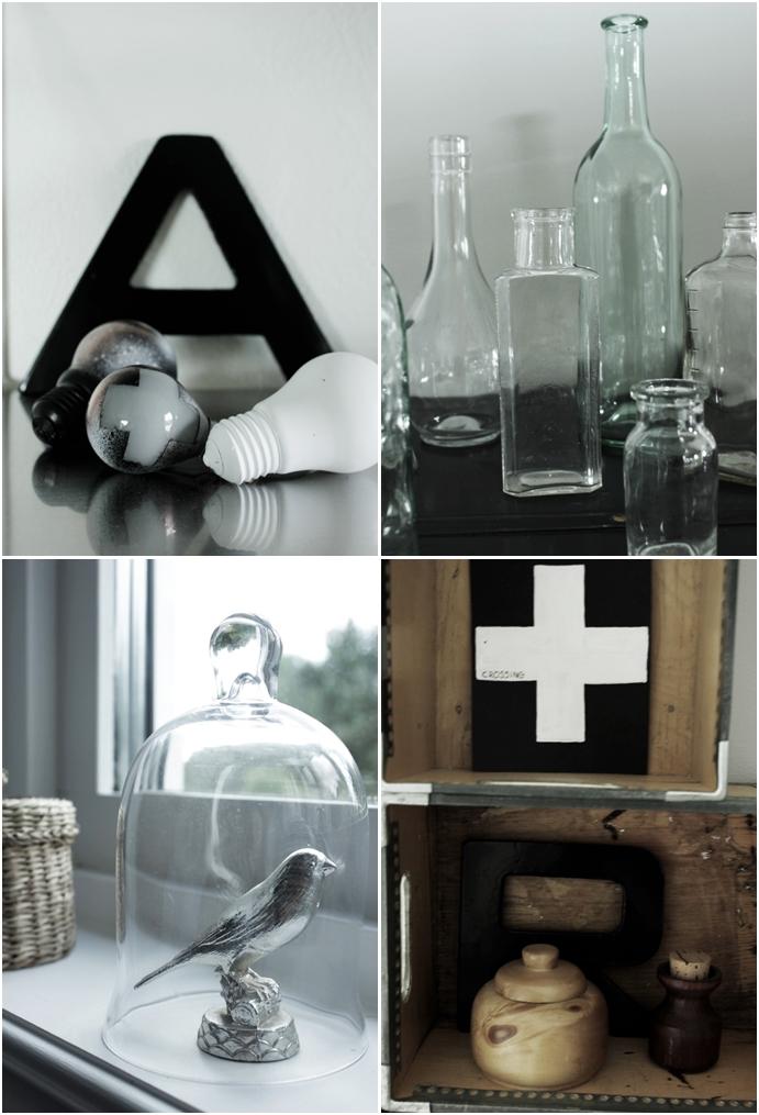 glödlampor, svart bokstav, järnbokstav, kors, glasflaskor, stilleben, glaskupa, fågel silver, trälådor, trärent,  inredningsdetaljer, svart och vitt,