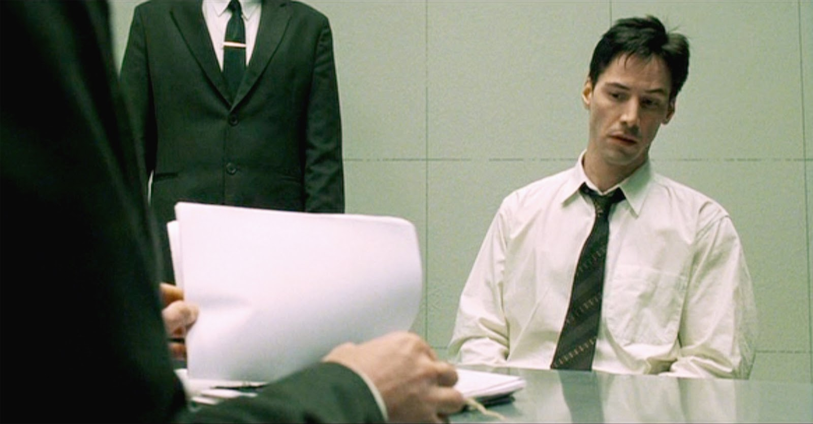 matrix the page 1 of 7 seen here keanu reeves as thomas a anderson neo being held and questioned