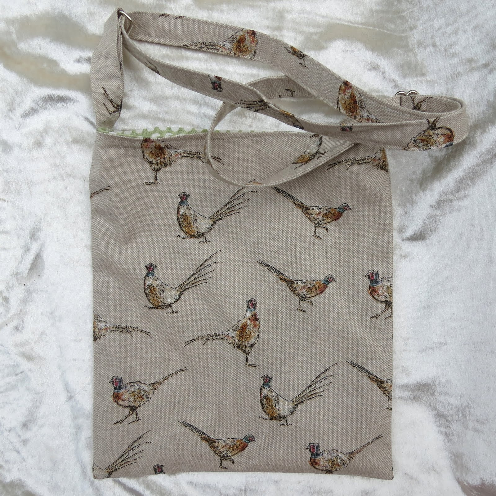 Drain bag.  A lined drain bag with an adjustable strap.  Pheasant design. Crossover drain bag.