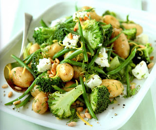 Hearty salad for the Easter weekend of potato, broccoli and goat's cheese in a lemony dressing