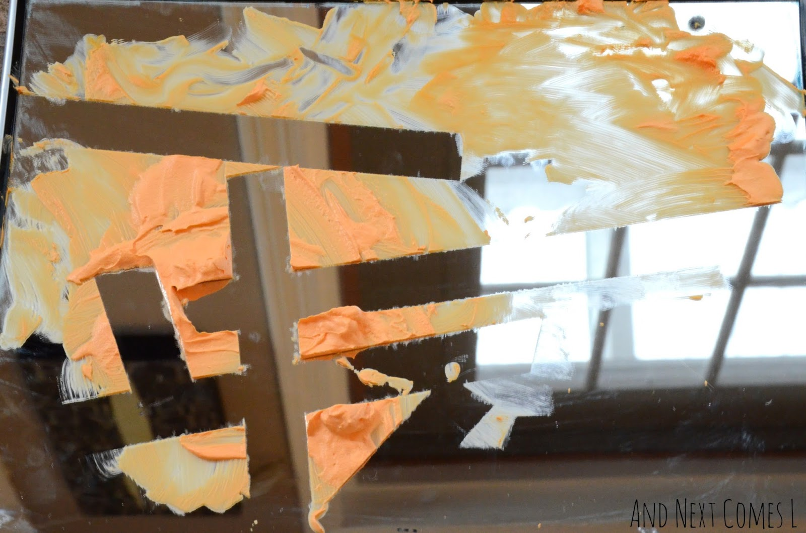 Tiger inspired tape resist mirror sensory play from And Next Comes L