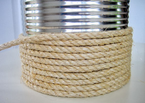 use a hot glue gun to secure the twine to the outside of the can