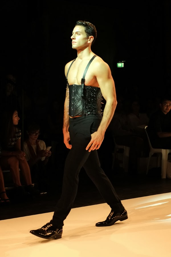 Li Tung Chou; black leather corset with shoulder straps, black pants - Menswear : Raffles Graduate Fashion Parade 2013 Photography by Kent Johnson.