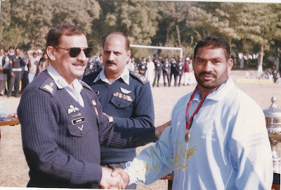 Officer giving Gold Medal to Muhammad Mansha Gujjar