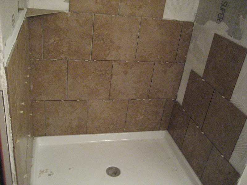 Shower tile going in! title=