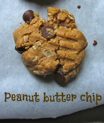Close-up of a chunky peanut butter, oatmeal, chocolate chip cookie on parchment paper